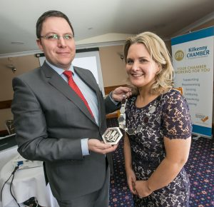Martin Costello passes the President's chain to new Kilkenny Chamber PresidentDeirdre Shine at the Kilkenny Chamber AGM. Photo: Pat Moore.