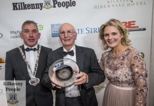 Paddy Kenna receives the Lifetime Achievement award from Matt Doran, Cathaoirleach Kilkenny COCO and Deirdre Shine, Kilkenny Chamber at the Kilkenny Chamber Business Awards. Photo: Pat Moore.